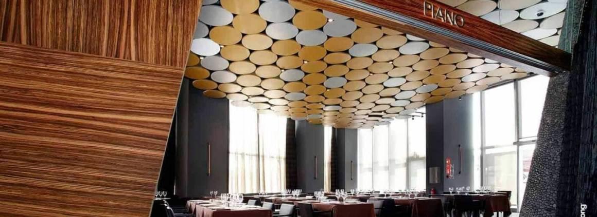 Leader en la matière Armstrong maîtrise la surface zénithale avec un large panel de solutions. Formes, matériaux… tous les projets trouvent chaussure à leur pied. Du bois, du minéral ou comme dans cette réalisation, du métal. Tous les critères sont pris en compte et participent à l'éloge de la réalisation : l'acoustique et la réflexion de la lumière, grâce à l'éclairage indirect. Au sein de l'hôtel Silken, le métal Canopy joue sur les formes concaves et convexes, suspendues à la charpente. Il met l'accent sur une zone, tout en laissant la possibilité à l'architecte de personnaliser le décor, avec un large choix de finitions. ©Armstrong