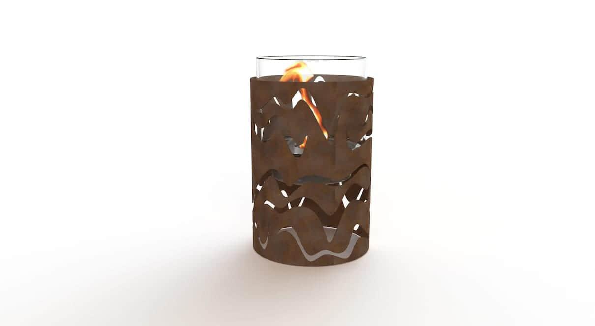 Samba - Un mouvement entraînant façonné par l'acier Corten, effet rouillé, pour illuminer les nuits d'été. Le foyer bio-éthanol se compose d'une vitre protectrice tubulaire haute température. 35 cm de diamètre. ©GlammFire