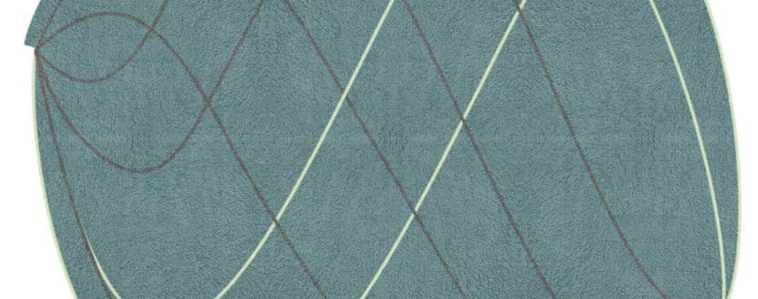 Driade, Twist - Tapis en laine et fibres naturelles, avec bords irréguliers et fils entrelacés, version vert forêt. Design Front. 240 x 300 cm. ©Driade