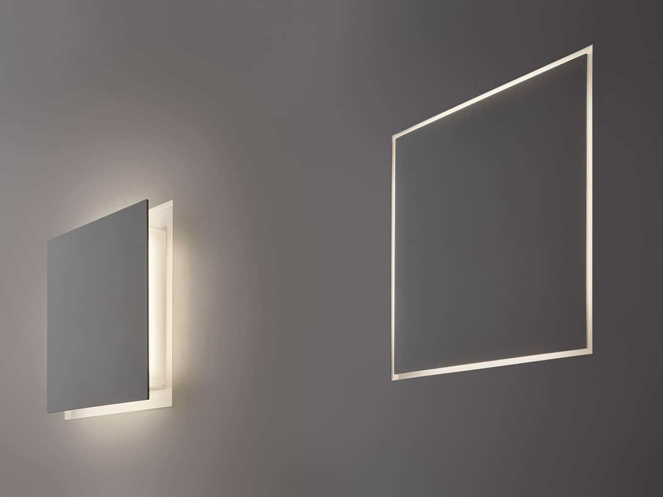 Lampe à encastrement mural Aldecimo rétractable avec mécanisme d'ouverture et de fermeture à pression - Source LED - Finition murale adaptée au support - Design Carmen Ferrara - ©Panzeri