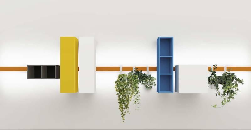 Composition libre d'unités murales Milo, accrochées à une barre en aluminium rétroéclairée. Design Enzo Berti. ©DVO