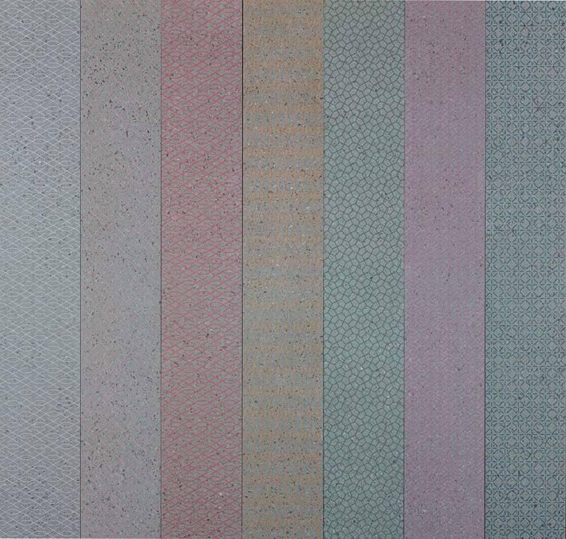 Pierres de lave grise « céramisée », stylisée avec 12 motifs et 7 coloris. 15 x 120 cm. ©Ornamenta