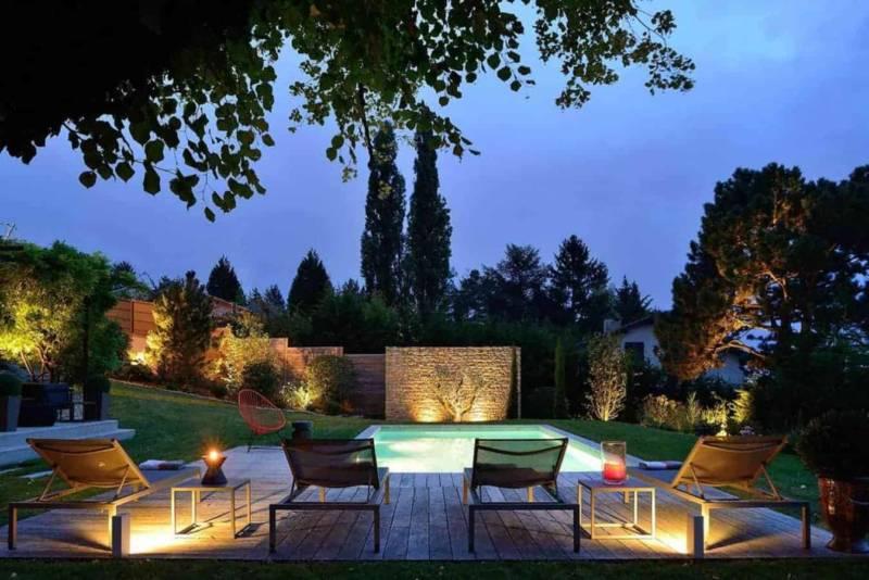 Vue piscine, réalisée par Piscine Concept (Lyon 5ème) Réalisation architecture d'intérieur Dorga - David Burles Photographe Erick Saillet