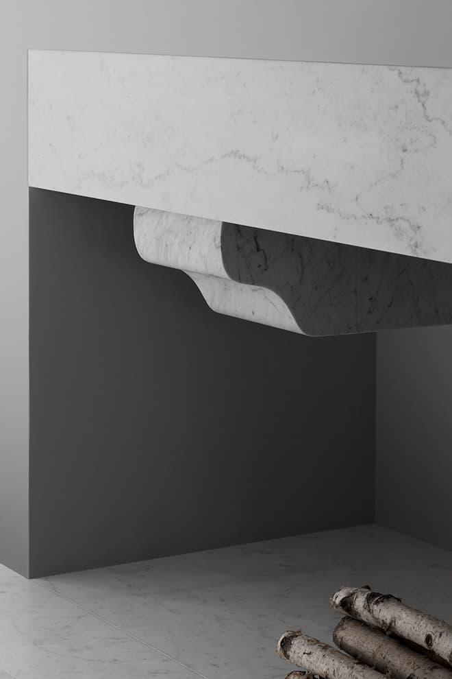 Sculptée à partir d'un seul bloc de marbre de Carrare, la cheminée s'inscrit comme un élément central du projet